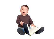 Beautiful baby with a book crying Stock Photography
