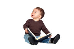 Beautiful baby with a book crying Royalty Free Stock Image