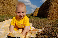 Beautiful baby boy against country landscape Royalty Free Stock Image