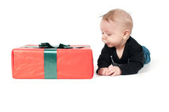 Beautiful baby boy and big christmas present Stock Photography