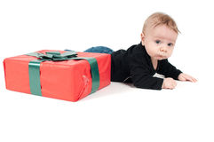 Beautiful baby boy with christmas present Stock Photos