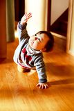 Beautiful baby boy crawling on the floor. royalty free stock photo