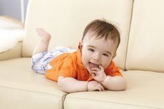 Beautiful baby boy lying on sofa Royalty Free Stock Photos