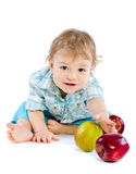 Beautiful baby boy play with green and red apples. Royalty Free Stock Photos