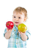 Beautiful baby boy play with green and red apples. Royalty Free Stock Images