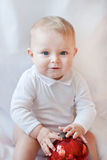 Beautiful baby boy playing with Christmas balls Royalty Free Stock Photos