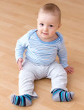 Beautiful baby boy sitting Royalty Free Stock Photos
