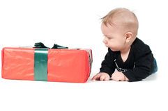 Beautiful baby boy watching on christmas present Royalty Free Stock Images