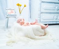 Beautiful baby  in the bright interior Royalty Free Stock Photos