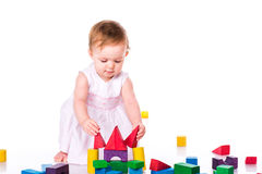 Beautiful baby building with cubes Stock Photos