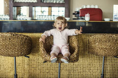 Beautiful baby in the cafe bar makes the order Royalty Free Stock Image