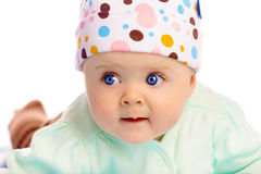 Beautiful baby in the cap. Close-up. Studio photo Royalty Free Stock Image