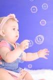 Beautiful baby catching bubbles. Shot of a beautiful baby catching bubbles Royalty Free Stock Photos
