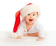 Beautiful baby in a Christmas hat isolated on white Royalty Free Stock Photos