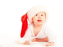 Beautiful baby in a Christmas hat isolated on white Stock Photo