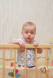 Beautiful baby in a cot Stock Images