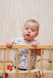 Beautiful baby in a cot Royalty Free Stock Photo
