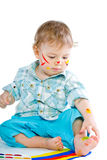 Beautiful baby covered in bright paint Royalty Free Stock Photography