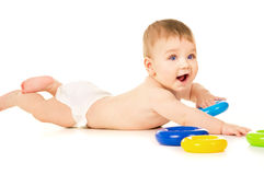 Beautiful baby crawling and playing with toys Stock Photography