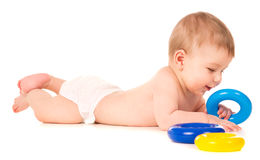 Beautiful baby crawling and playing with toys. Isolated on white background stock photo