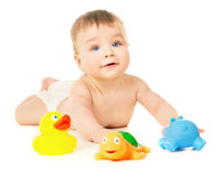 Beautiful baby crawling and playing with toys Stock Photos