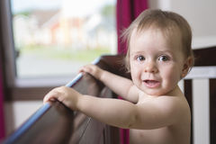 Beautiful baby in a crib at home Royalty Free Stock Image