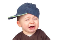 Beautiful baby crying with a cap. Isolated on white background Royalty Free Stock Photography