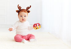 Beautiful baby dear playing with toy at home Stock Images
