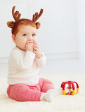 Beautiful baby dear playing with toy at home Royalty Free Stock Photo