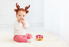 Beautiful baby dear playing with toy at home Stock Image