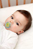 Beautiful baby with dummy Royalty Free Stock Photography