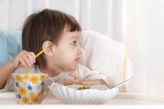 Beautiful baby eating Stock Photos