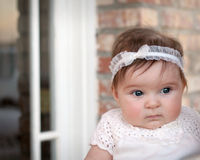 Beautiful Baby Girl. Close-up outdoor portrait of a baby girl in a white dress Royalty Free Stock Images