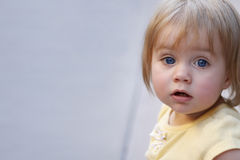 Beautiful baby girl. Baby girl with blue eyes & endearing expression with room for text Stock Image