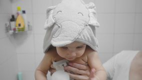 Beautiful baby girl after a bath. Candid, real life footage stock video footage