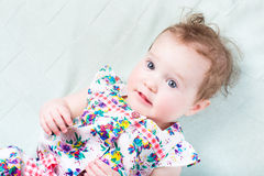 Beautiful baby girl with big blue eyes Stock Image