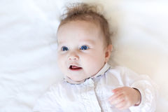Beautiful baby girl with big blue eyes on white bl Royalty Free Stock Images