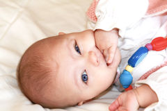 Beautiful baby girl with blue eyes royalty free stock photo