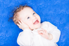 Beautiful baby girl on a blue paisley blanket Royalty Free Stock Photo