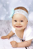 Beautiful baby girl crawling on the floor and laughing Stock Photos