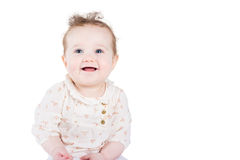 Beautiful baby girl with curly hair in an elegant shirt Stock Photography