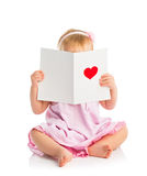 Beautiful baby girl with cute valentine postcard with a red hear. T  on white background Stock Photography
