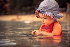 Beautiful baby girl enjoy swimming in sea during beach holidays Royalty Free Stock Images