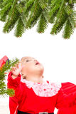 Beautiful baby girl in front of the christmas tree Royalty Free Stock Images