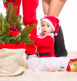 Beautiful baby girl in front of the christmas tree Royalty Free Stock Photography