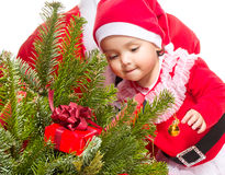 Beautiful baby girl in front of the christmas tree Royalty Free Stock Photo