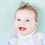 Beautiful baby girl on a green blanket Royalty Free Stock Photography