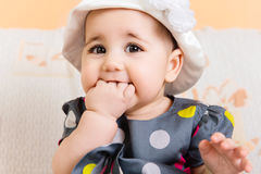 Beautiful baby girl in hat and dress Royalty Free Stock Photos