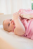 Beautiful baby girl in her crib Stock Images