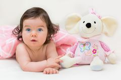 Beautiful baby girl with her favorite toy Royalty Free Stock Images